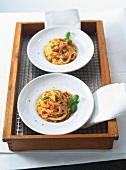 Bavette all'amatriciana (Nudeln mit Speck-Tomaten-Sauce)