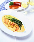 Lobster in lobster cream sauce with green asparagus
