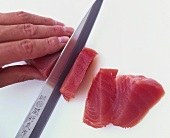 Slicing tuna fillet