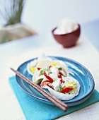 Fish salad with marinated Chinese cabbage in prawn crackers