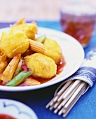 Sweet and sour coley in tandoori batter