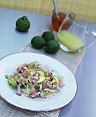 Green papaya salad with calamaretti and honey