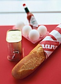 Baguette, tin of corned beef, eggs and tabasco