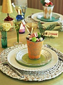 Place-setting with beaker of sweets and place-card