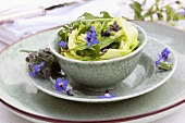 Lettuce hearts with rocket and borage flowers