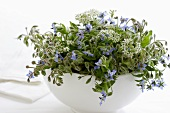 Borage and garlic chive flowers in a bowl