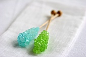 Blue and green sugar swizzle sticks
