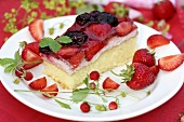 A piece of strawberry and blackberry cake
