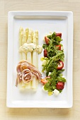 White asparagus with ham and rocket & strawberry salad