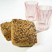 Two wholemeal rolls and two glasses