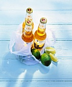 Three bottles of Corona (Mexican beer) with limes