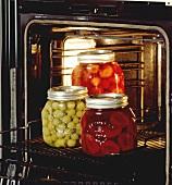 Bottling plums, strawberries and gooseberries