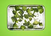 Frozen broccoli on a silver platter