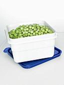 Frozen peas in a plastic box