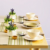 Laid table with posies of lavender as table decorations