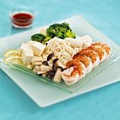 Mixed platter of shrimps, mushrooms and tofu