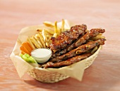 Spare-ribs and chips in a basket
