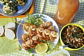 Skewered shrimps and chick-pea salad for picnic