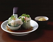 Rice paper rolls filled with giant freshwater prawns, dip