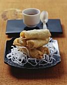 Mini-spring rolls on deep-fried glass noodles