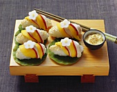 Nigiri sushi with chicken and mango