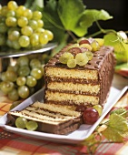 Sponge slice with chocolate cream and sugared grapes