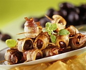 Bacon-wrapped prunes on a platter