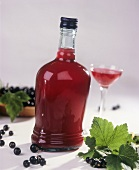 Blackcurrant liqueur in bottle and glass