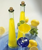 Lemon vodka in two bottles and a glass