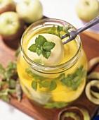 Apples bottled in mint syrup