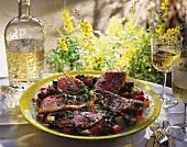 Grilled red mullet fillet with herbs on vegetables