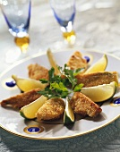 Breaded fennel with lime wedges