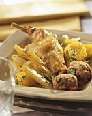 Rabbit leg with meatballs, potatoes and celery