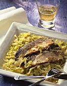 Fried mackerel fillets on honey sauerkraut