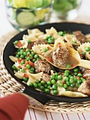 Bow-tie pasta with meatballs and peas