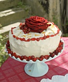 Carrot cake with soft cheese icing and redcurrants