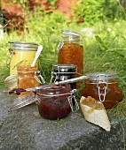 An assortment of jams in preserving jars