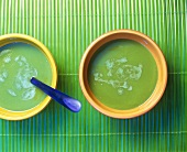 Two bowls of cream pea soup