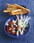 Goat's cheese and tomato salad with savoury sticks