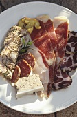 Hearty snack with ham, brawn and terrine