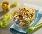 Chicken salad with rice, raisins, pineapple and sweetcorn