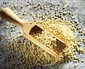 Sesame seeds with wooden scoop