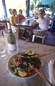 Fried spiny lobster with wine in a hotel (Caribbean)