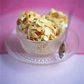 Three scoops of almond ice cream with flaked almonds