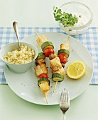 Chicken and vegetable kebabs with rice