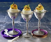 Three eggs stuffed with capers and shrimps in goblets