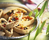 Pita bread filled with peppers, olives and sheep's cheese