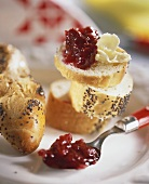 Poppy seed plait with butter and cherry jam
