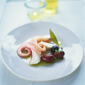 Marinated octopus arms with olives