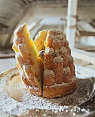 Sponge cake with candied fruit and a ring